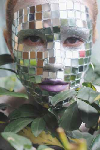 woman with mosaic face mask