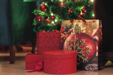 assorted gift boxes under christmas tree