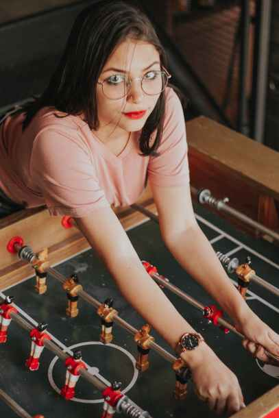 woman leaning on foosball