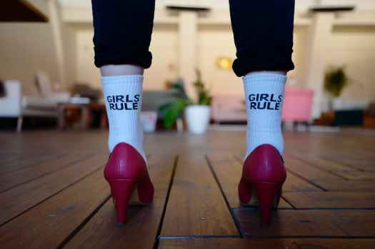 person wearing pair of white girls rule text printed socks